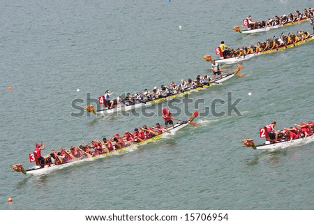 Dragon boat heading to the finish line in Club Crew World Championships 2008 (Held on 31 July - 3 August 2008 in Penang, Malaysia) - stock photo