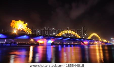 Dragon bridge by night in Danang city, Central of Vietnam - stock photo