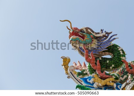 dragon chinese temple roof and blue sky in thailand