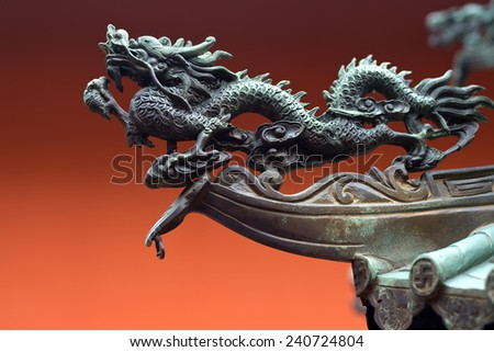 Dragon detail at a temple in SIngapore - stock photo