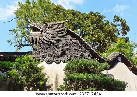 Dragon detail On the wall in Yuyuan Garden, Shanghai China - stock photo