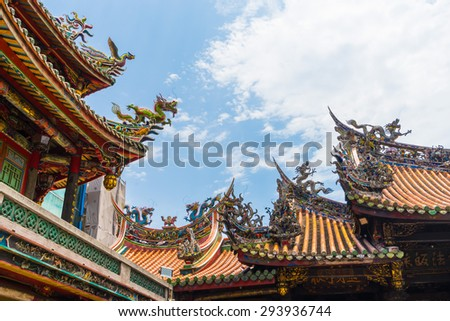 Dragon from the roof of Longshan Temple in Taipei, Taiwan - stock photo