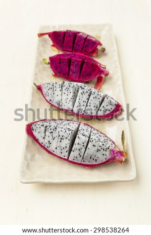 Dragon fruit on ceramic plate vertical style