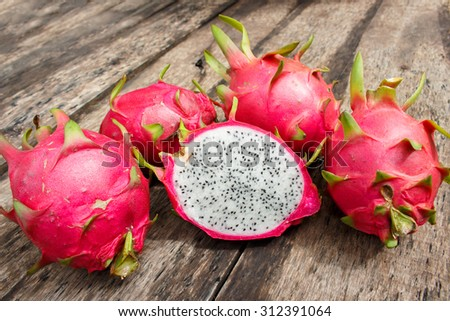 Dragon Fruit On old Wooden Table - stock photo