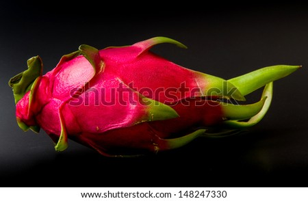 Dragon fruits on black background