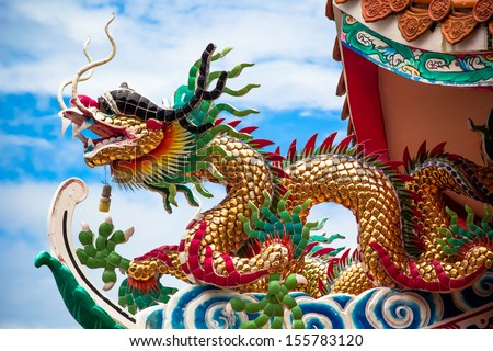 Dragon on the roof of Chinese temple - stock photo