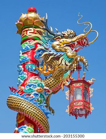 Dragon pole against blue sky - stock photo