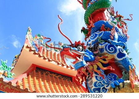 Dragon sculpture in Chinese temple with blue sky - stock photo