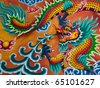 Dragon sculpture on wall of temple in Thailand - stock photo