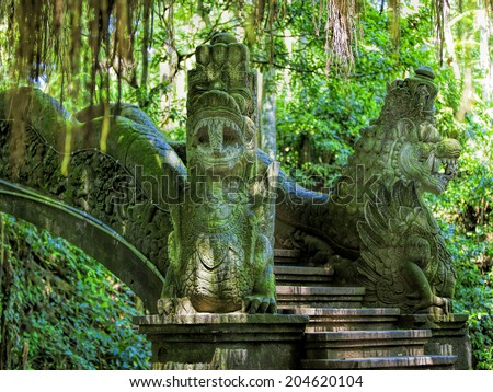 Dragon sculptures in the monkey forest, Bali, Indonesia - stock photo