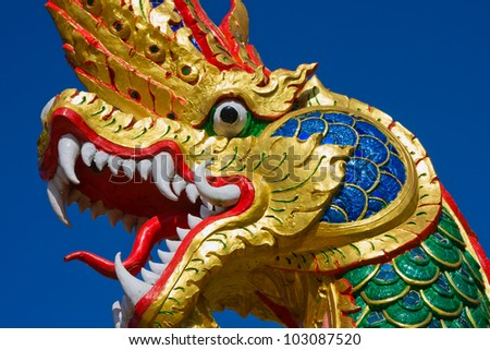 Dragon statue at a temple in Thailand - stock photo