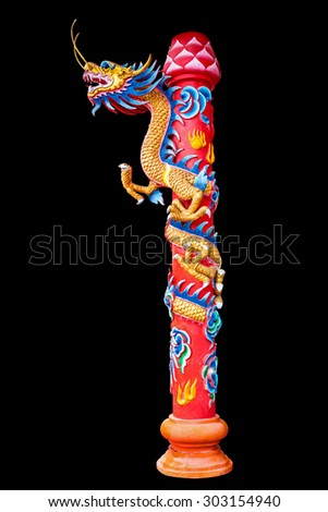 Dragon statue chinese style wrapped around the pole on black, work with clipping path. - stock photo