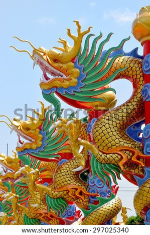 dragon statue on china temple roof - stock photo