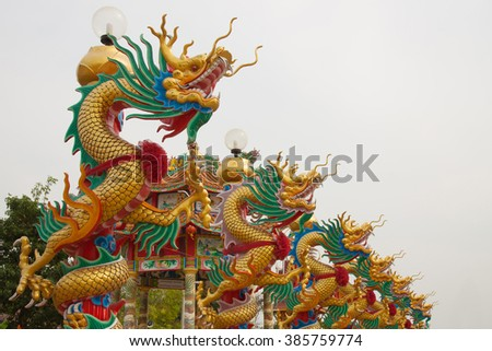 Dragon statue on pillar at chinese temple