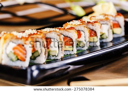 Dragon sushi roll with red snapper and eel - stock photo