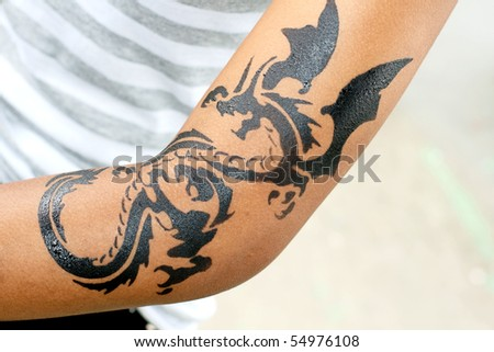 dragon tattoo on female arm
