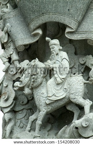 Dragon Village, Chinese Dragon Stone Carving Column Outside Taoist Temple in Suphanburi, Thailand  - stock photo