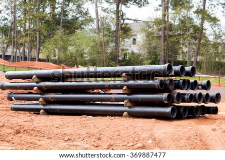 Drain and sewer pipes in dirt at a residential construction site