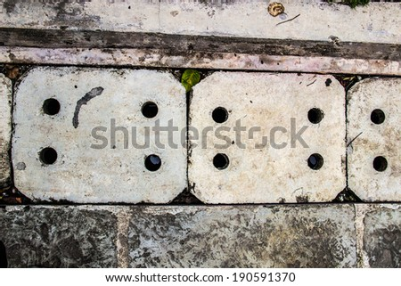 Drain grate in concrete floor as abstract background - stock photo