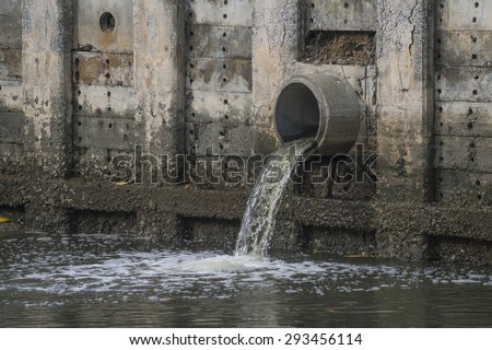 Drain water - allow to drain into the canal. - stock photo
