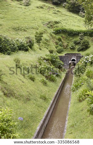 Drainage channel water in Lagoa Azul. Sete Cidades. Azores, Portugal. Vertical - stock photo