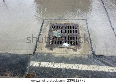 drainage cover on the road - stock photo