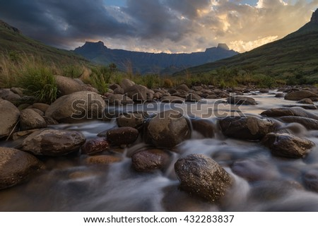 Drakensberg Amphitheatre view from the Bushmans River during an epic sunset.