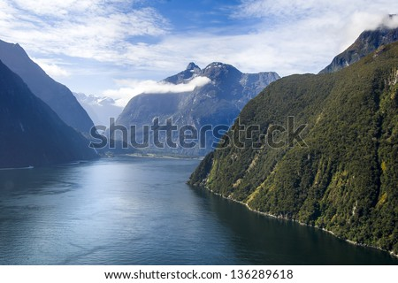 Dramatic aerial view of New Zealand's Milford Sound - stock photo