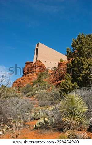 Dramatic architecture of the Chapel of the Holy Cross amidst the vibrant red rocks in the Sedona area. - stock photo