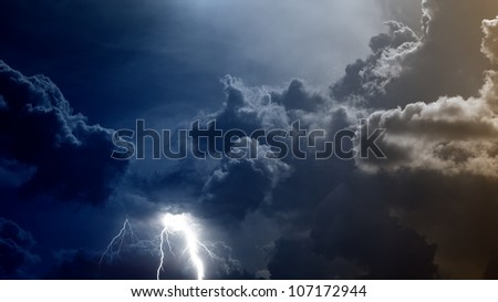 Dramatic background - dark sky and clouds with lightnings - stock photo