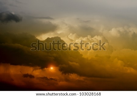 Dramatic background - dark sky and red light from sun - stock photo