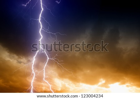 Dramatic background - lightning on sunset sky with dark clouds - stock photo
