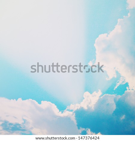 Dramatic blue sky with clouds and sunbeams, retro filter effect - stock photo