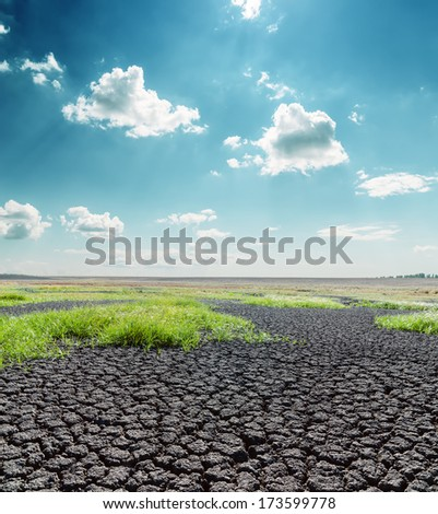 dramatic blue sky with clouds over desert - stock photo