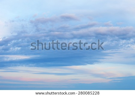 Dramatic blurred fluffy clouds on vivid blue sky - stock photo