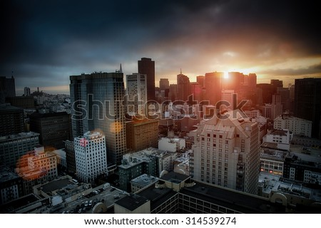 Dramatic breaking dawn over San Francisco with sunlight flare - stock photo