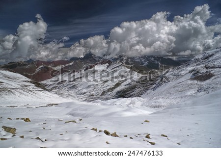 Dramatic clouds above high altitude south american Andes in Peru, Ausangate