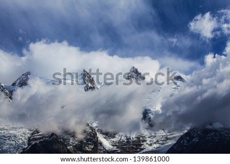 Dramatic clouds and rocky peaks in the Alps