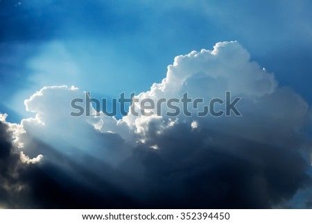 Dramatic Clouds and Sky with Sunbeam - stock photo