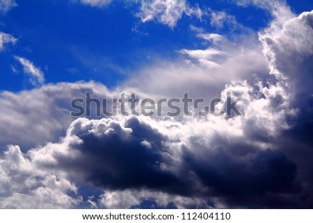 dramatic clouds in the blue sky - stock photo