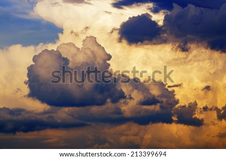 Dramatic clouds on the blue sky on the sunset, natural background - stock photo