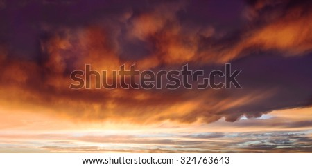dramatic clouds over golden sunset