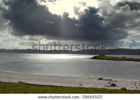 Dramatic clouds over Loch Dunvegan, Skye - stock photo