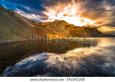 Dramatic Clouds Reflection in Crystal Lake, at the top of 11,789 foot Ophir Pass,