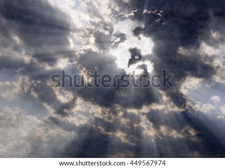 Dramatic clouds with sunbeams formed the face of Jesus Christ - stock photo