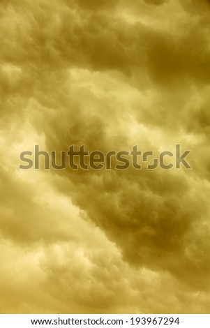 Dramatic cloudscape. Dark stormy clouds covering the sky as nature background. Meteorology. Sepia tone. - stock photo