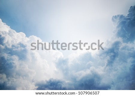 dramatic cloudscape with sunlight in the background