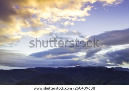 Dramatic cloudy dawn in Crimean Mountains - stock photo