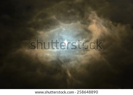 Dramatic cloudy sunset with sunbeams. Reflected clouds and sun in the lake. Deep clouds. Eye of day - stock photo