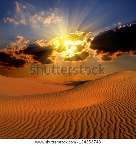 dramatic cloudy suset landscape in desert - stock photo